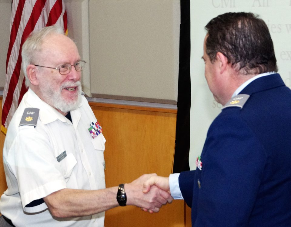 Major Philip Feldman (r), Putnam County Composite Squadron Deputy Commander, congratulates squadron Aerospace Education Officer Ralph Langham (l) on his promotion to major during the squadron awards ceremony held on March 31, 2017 at the Putnam County Bureau of Emergency Services in Carmel, NY. (Photo: Major Peter Milano)