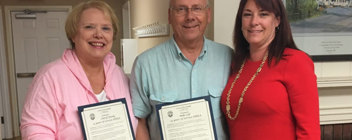 Cheryl Reedy and Mike Gill with First Selectman Susan Chapman