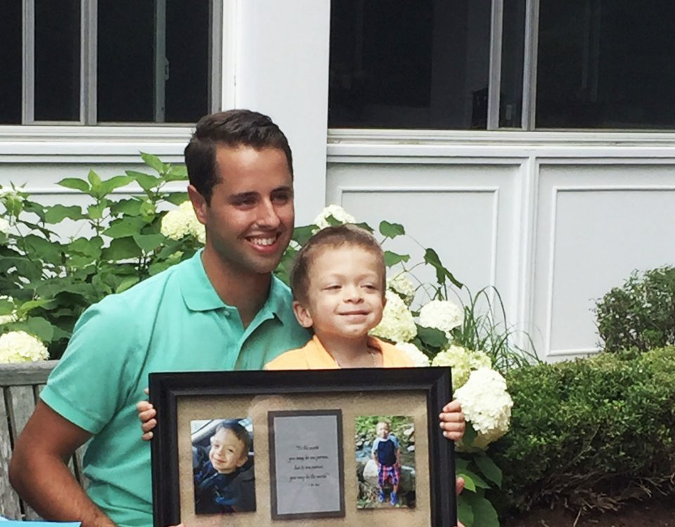 After exchanging hugs, Bryson presents Cory with a gift of beautifully framed photos so he will always remember their first meeting.