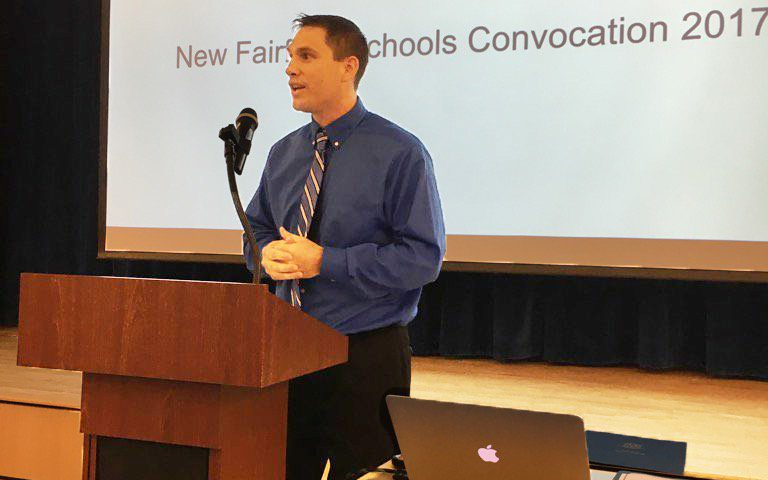 Matthew Schlosser, District Teacher of the Year, address the group at Opening Convocation