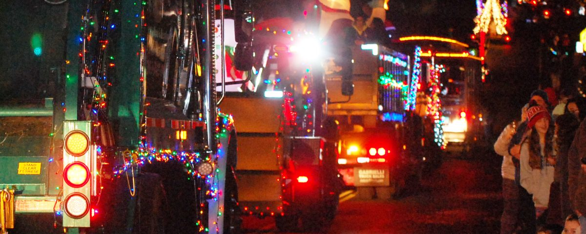Residents line the street to watch lighted trucks and floats in New Fairfield's Holiday Light Parade (Photo by Jeannie Ruggiero)
